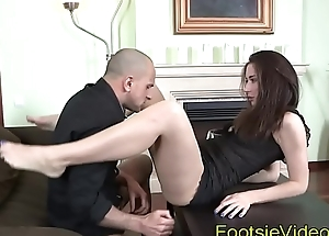 Kinky babe gives foot tug