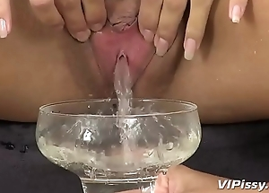Gorgeous girls piddle and toy in this seductive close-up lesbian scene