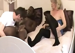 Cuckold sucks BBC and enjoys his wife fucking BBC