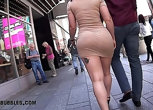 Shapely Latina in Tan Colored Super Short Clothing