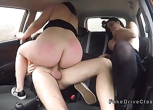 Threesome in fake driving school car