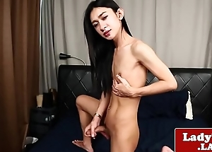 Solo ladyboy tugs her cock until she creams