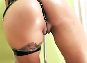 Big Ass Brunette Oiling Her Muff and Masturbating