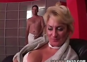 Busty Grandma is getting their way pussy stuffed